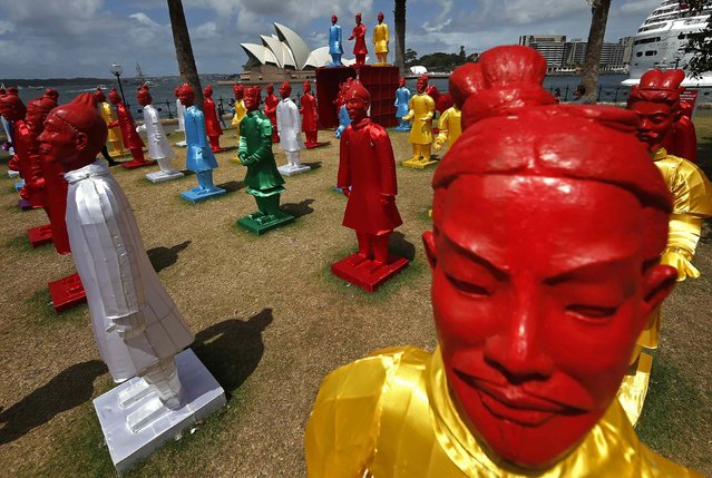 "An art installation called the ""Lanterns of the Terracotta Warriors"" stands in front of the Sydney Opera House February 19, 2015. (Photo by David Gray/Reuters)"
