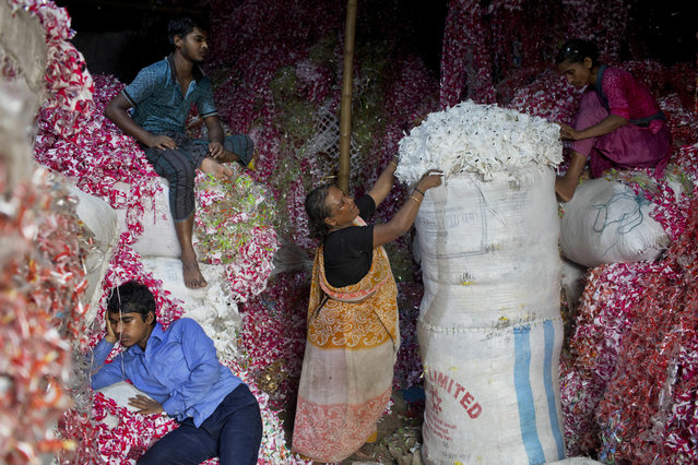 "Bangladeshis work at a plastic strips storehouse in Dhaka, Bangladesh, Monday, June 4, 2018. The theme for this year's World Environment Day, marked on June 5, is ""Beat Plastic Pollution"". (Photo by A.M. Ahad/AP Photo)"