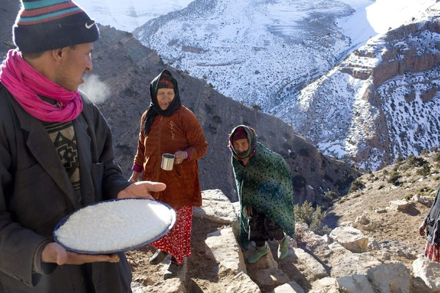 A man serves Berber speciality foods in Ait Sghir village in the High Atlas region of Morocco February 14, 2015. (Photo by Youssef Boudlal/Reuters)