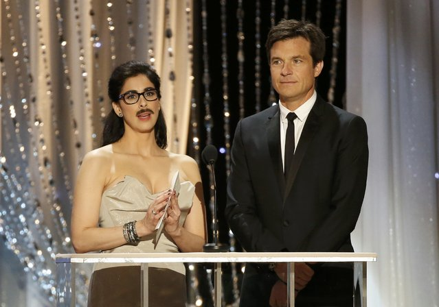 Presenter Sarah Silverman wears a mustache as she stands with actor Jason Bateman to announce the winner of the award for Outstanding Performance by a Male Actor in a Comedy Series at the 22nd Screen Actors Guild Awards in Los Angeles, California January 30, 2016. (Photo by Lucy Nicholson/Reuters)