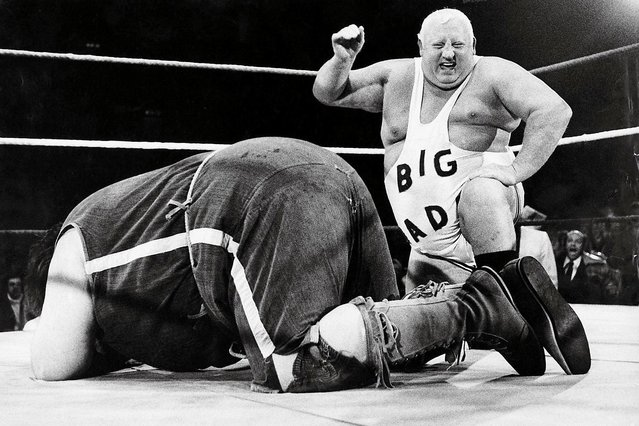 Giant Haystacks, aka Martin Ruane (1946 – 1998), and Big Daddy, aka Shirley Crabtree (1930 – 1997) wrestling at Wembley Arena, London, 18th June 1981. (Photo by Eamonn McCabe/Redferns)