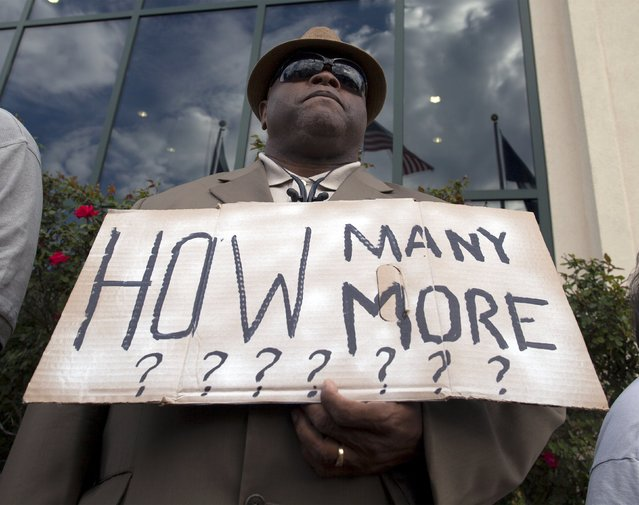 Rev. Arthur Prioleau of Goose Creek, South Carolina, carries a sign at a rally in North Charleston, South Carolina April 8, 2015. (Photo by Randall Hill/Reuters)
