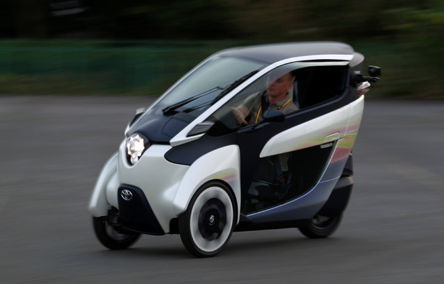 A journalist drives a Toyota ultra-compact, tandem two-seater electric vehicle i-ROAD during the Toyota Advanced Technologies media briefing in Tokyo, October 10, 2013. (Photo by Yuya Shino/Reuters)