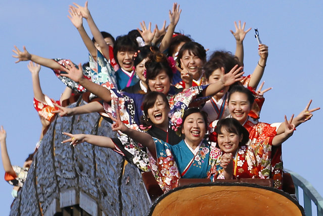 Kimono-clad women who celebrate turning 20 years old react as they ride a roller coaster following a coming of age ceremony at Toshimaen amusement park on Coming of Age Day national holiday in Tokyo, Monday, January 9, 2017. The day is marked by those who turned 20 in the past year after April 1 or will be 20 before March 31 this year. (Photo by Shizuo Kambayashi/AP Photo)