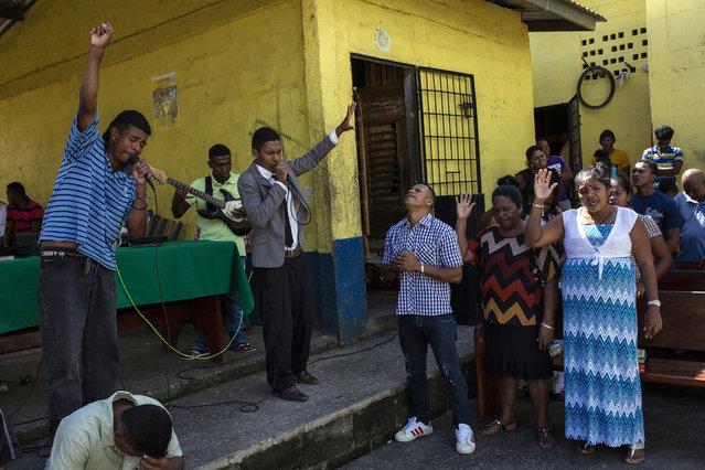 In this February 10, 2018 photo, evangelical pastors preach to inmates inside a prison in Puerto Lempira, Honduras. (Photo by Rodrigo Abd/AP Photo)