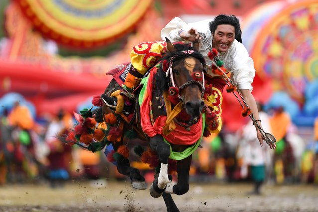 A local resident performs traditional horse racing during a celebration marking the 70th anniversary of the founding of Yushu Tibetan Autonomous Prefecture, in northwest China's Qinghai Province, August 4, 2021. (Photo by Xinhua News Agency/Rex Features/Shutterstock)