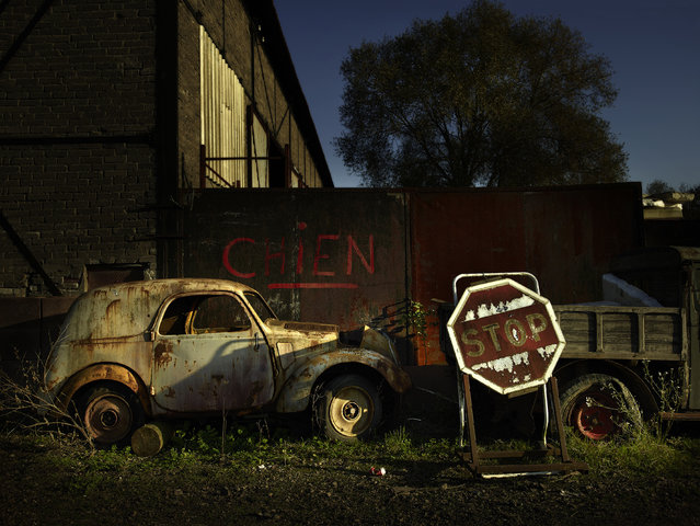 """A """"Stop"""" sign is seen near an abandoned motor, in 2013, in France. (Photo by Dieter Klein/Barcroft Media)"""