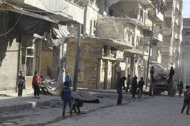 Residents inspect damage after an airstrike on the rebel held al-Fardous neighbourhood of Aleppo, Syria February 18, 2016. (Photo by Abdalrhman Ismail/Reuters)