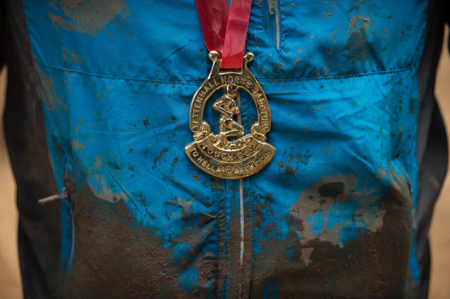 A competitor wears his finisher's medal having taken part in the Tough Guy endurance event near Wolverhampton, central England, on January 27, 2019. (Photo by Oli Scarff/AFP Photo)