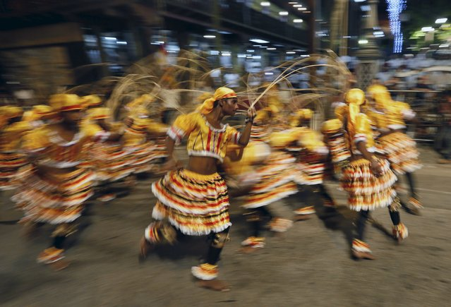 Sri Lankan traditional dancers perform during the annual Nawam Perahera street parade in Colombo February 22, 2016. (Photo by Dinuka Liyanawatte/Reuters)
