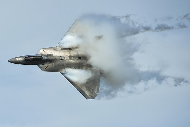 A U.S. Air Force F-22 Raptor takes to the sky at the Gulf Coast Salute open house and air show over Tyndall Air Force Base near Panama City, Florida, in this picture taken April 11 and released April 15, 2015. (Photo by Tech. Sgt. Javier Cruz/Reuters/U.S. Air Force)