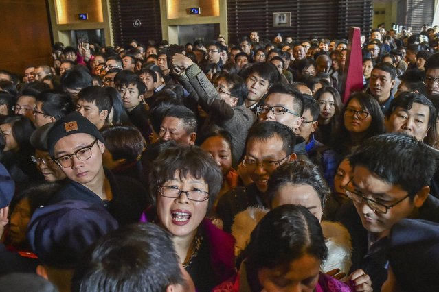 A crowd waits as a residential compound opens for sell in Hangzhou, Zhejiang Province, China, Picture taken February 27, 2016. (Photo by Reuters/Stringer)
