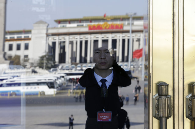 A security officer stands guard ahead of the second plenary session of the National People's Congress (NPC) in Beijing, China, March 9, 2016. (Photo by Jason Lee/Reuters)