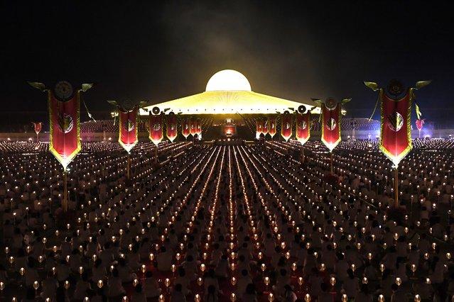 This photo taken on February 19, 2019 shows devotees praying to mark Makha Bucha Day at the Wat Phra Dhammakaya temple, near Bangkok. (Photo by Lillian Suwanrumpha/AFP Photo)