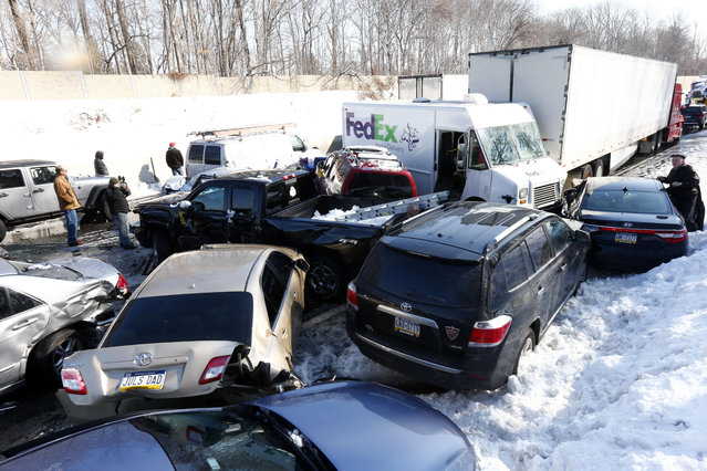 Vehicles are piled up in an accident, Friday, February 14, 2014, in Bensalem, Pa. Traffic accidents involving multiple tractor trailers and dozens of cars have completely blocked one side of the Pennsylvania Turnpike outside Philadelphia and caused some injuries. (Photo by Matt Rourke/AP Photo)