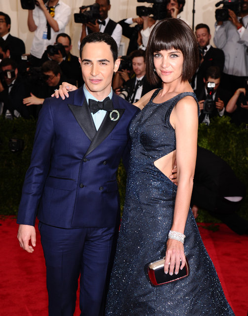 "Zac Posen, left, and Katie Holmes arrive at The Metropolitan Museum of Art's Costume Institute benefit gala celebrating ""China: Through the Looking Glass"" on Monday, May 4, 2015, in New York. (Photo by Charles Sykes/Invision/AP Photo)"