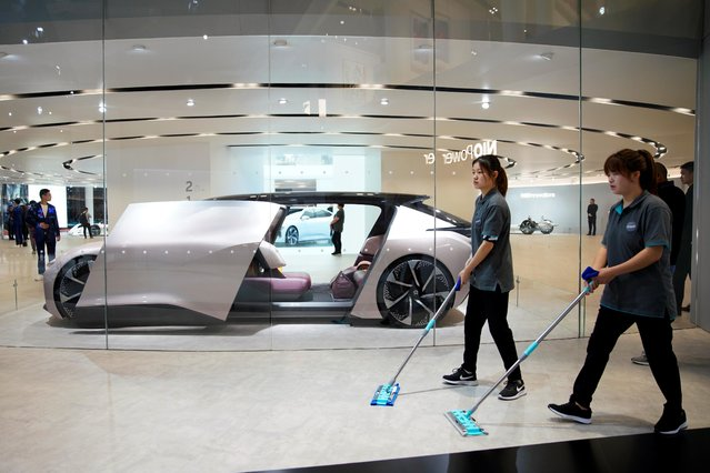 Cleaners are seen next to a self-driving electric concept car NIO Eve displayed at the second media day for the Shanghai auto show in Shanghai, China April 17, 2019. The 18th Shanghai international automobile industry exhibition runs from 16 to 25 April. (Photo by Aly Song/Reuters)