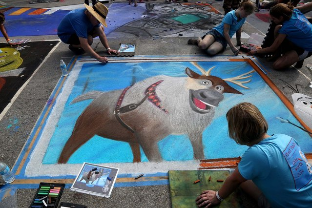 "Mike Hicks, Jordan Cox, Maggie Cox and Anne Cox paint the character Sven from the movie ""Frozen"".  (Photo by Greg Lovett/The Palm Beach Post)"