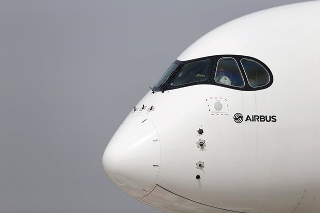 A pilot sits in the cockpit of an Airbus A350 XWB aircraft ahead of the International Air and Space Fair (FIDAE) at Santiago international airport, March 28, 2016. (Photo by Ivan Alvarado/Reuters)
