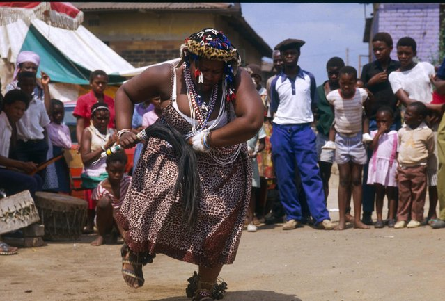 """Pictured here is Nelisiwe, a Sangoma who teaches """"Sangoma students"""" traditional dance at her Tugala Ferry home. Location: Tugala Ferry, South Africa. (Photo by Patrick Durand/Sygma via Getty Images)"""
