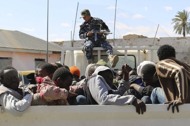Migrants sit on truck as they arrive at a detention center after they were detained by the Libyan authorities in Tripoli, Libya May 17, 2015. (Photo by Hani Amara/Reuters)