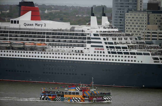 A mersey ferry passes the Cunard liner Queen Mary 2 on the River Mersey in Liverpool, Britain May 25, 2015. Three Cunard ships, Queen Mary 2, Queen Elizabeth and Queen Victoria are in the city for the 175th anniversary of the Cunard cruise line. (Photo by Phil Noble/Reuters)