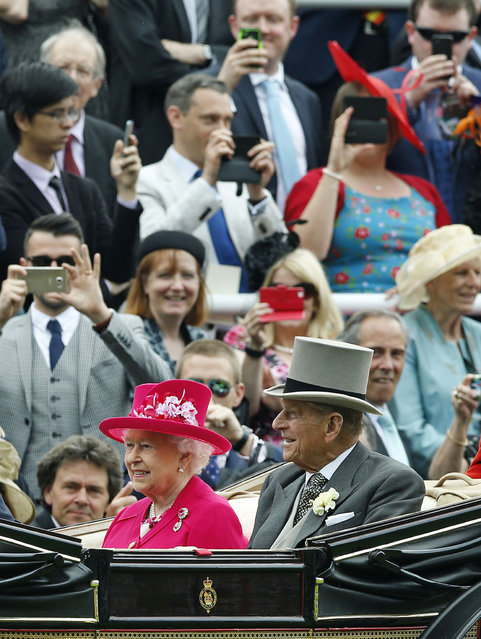 Britain's Queen Elizabeth II arrives with Prince Philip, the Duke of Edinburgh for the first day of  Royal Ascot horse racing meet at Ascot, England, Tuesday, June 16, 2015. Royal Ascot is the annual five day horse race meeting that Britain's Queen Elizabeth II attends every day of the event. (AP Photo/Alastair Grant)