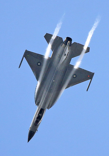 The JF-17 Thunder multi-role fighter jointly developed by China and Pakistan performs its demonstration flight at the Paris Air Show in Le Bourget, north of Paris, Tuesday June 16, 2015. Some 300,000 aviation professionals and spectators are expected at this week's Paris Air Show, coming from around the world to make business deals and see dramatic displays of aeronautic prowess and the latest air and space technology. (AP Photo/Remy de la Mauviniere)