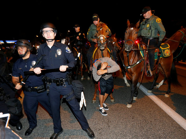Sheriffs on horseback and police break up a group of demonstrators outside Republican U.S. presidential candidate Donald Trump's campaign rally in Costa Mesa, California, April 28, 201. (Photo by Mike Blake/Reuters)