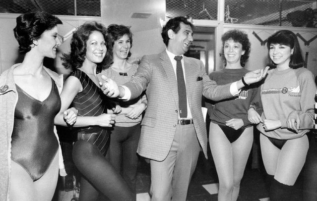 "In this February 27, 1984, file photo, singer Placido Domingo laughs with members of the Rockettes at New York's Radio City Music Hall. The singer and dancers met while rehearsing for Channel Thirteen's ""Gala of Stars 1984"". Nine women in the opera world have told The Associated Press that they were sexually harassed by Domingo, one of the most celebrated and powerful men in opera. The women say the encounters took place over three decades, at venues that included opera companies where he held top managerial positions. (Photo by Steve Friedman/AP Photo/File)"