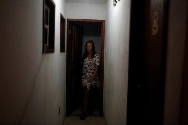 A tourist leaves her room at Pousada Favelinha (Little favela) hostel in Pereira da Silva favela, in Rio de Janeiro, Brazil, April 29, 2016. (Photo by Pilar Olivares/Reuters)