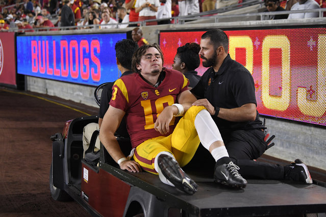 Southern California quarterback JT Daniels is carted off the field after being injured during the first half of an NCAA college football game against Fresno State Saturday, August 31, 2019, in Los Angeles. (Photo by Mark J. Terrill/AP Photo)