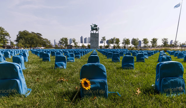 A view of 3,758 school backpacks assembled by UNICEF as an installation on the North Lawn of United Nations headquarters to resemble gravestones as a reminder of the large number of children who were killed or injured in conflict zones, in New York, New York, USA, 11 September 2019. According to a 2019 annual report released by the United Nations' Secretary-General on children and armed conflict, over 12 thousand children were killed or maimed in conflict zones in 2018, the largest number of reported casualties since statistics were first assembled by the United Nations. (Photo by Justin Lane/EPA/EFE)