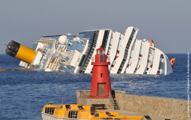 The cruise ship Costa Concordia lies stricken off the shore of the island of Giglio in Giglio Porto, Italy