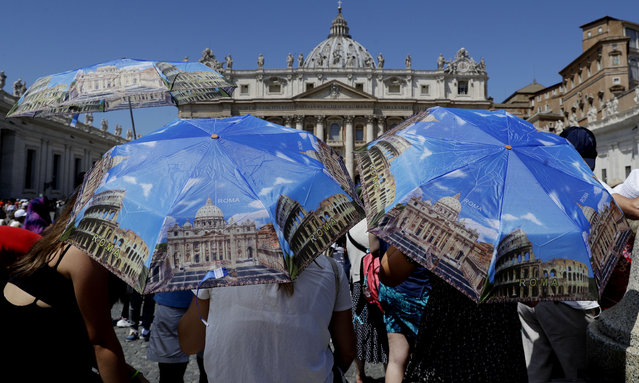"""Faithful gather in St. Peter's Square as they wait for Pope Francis to recite the Angelus noon prayer, at the Vatican, Sunday, July 21, 2019. Pope Francis is hoping that the 50th anniversary of the first moon walk inspires efforts to help our """"common home"""" on Earth. Francis told the public in St. Peter's Square on Sunday, the day after the anniversary of the July 20, 1969, lunar landing, that the feat achieved an """"extraordinary dream"""". (Photo by Gregorio Borgia/AP Photo)"""