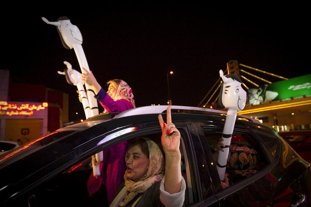 Iranians celebrate in the streets following a nuclear deal with six major world powers, in Tehran July 14, 2015. (Photo by Reuters/TIMA)
