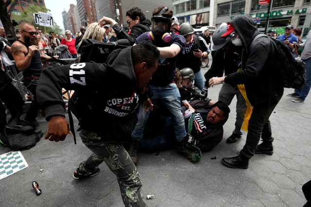 Demonstrators clash with people opposing their rally during a May Day protest in Union Square in New York City on May 1, 2017. (Photo by Mike Segar/Reuters)