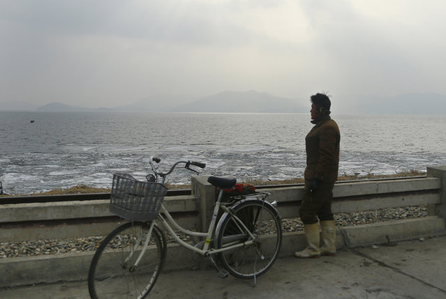 In this February 2, 2019, photo, a North Korean man looks out to the sea as he stands on the West Sea Barrage in Nampo, North Korea. (Photo by Dita Alangkara/AP Photo)