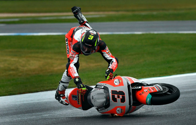 Kiefer Racing Moto2 rider Lukas Tulovic of Germany crashes during a practice session at Phillip Island on October 25, 2019, ahead of the MotoGP Australian Grand Prix. (Photo by William West/AFP Photo)