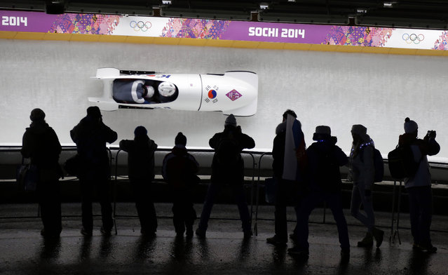 The team from South Korea KOR-1, piloted by Won Yunjong  and brakeman Seo Youngwoo, take a curve during the men's two-man bobsled competition at the 2014 Winter Olympics, Monday, February 17, 2014, in Krasnaya Polyana, Russia. (Photo by Natacha Pisarenko/AP Photo)