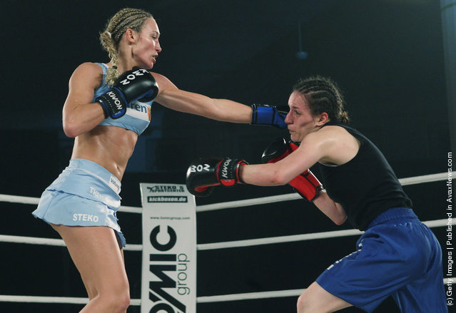 German kickboxer Christine Theiss hits challenger Olja Zerajic of Bosnia during their WKA middleweight title fight at Postpalast