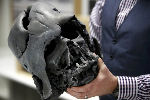 "A finished replica of Darth Vader's melted helmet from ""Star Wars: The Force Awakens"", is seen in the Propshop headquarters at Pinewood Studios near London, Britain May 25, 2016. (Photo by Peter Nicholls/Reuters)"