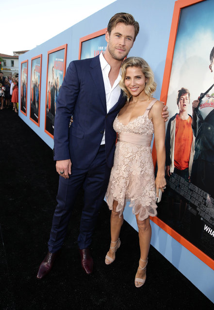 """Chris Hemsworth and Elsa Pataky seen at the New Line Cinema presents the Premiere of """"Vacation"""" held at Regency Village Theatre on Monday, July 27, 2015, in Westwood, Calif. (Photo by Eric Charbonneau/Invision for Warner Bros./AP Images)"""