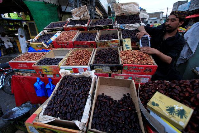 A vendor prepares his display of dates ahead of Ramadan in Rawalpindi, Pakistan, May 31, 2016. (Photo by Faisal Mahmood/Reuters)