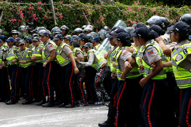 Female police officers clash with demonstrators during a protest called by university students against Venezuela's government in Caracas, Venezuela, June 9, 2016. (Photo by Carlos Garcia Rawlins/Reuters)