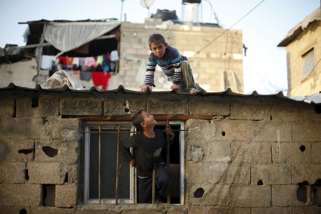 Palestinian boys play at their family house in Biet Lahiya town in the northern Gaza Strip March 24, 2015. (Photo by Mohammed Salem/Reuters)