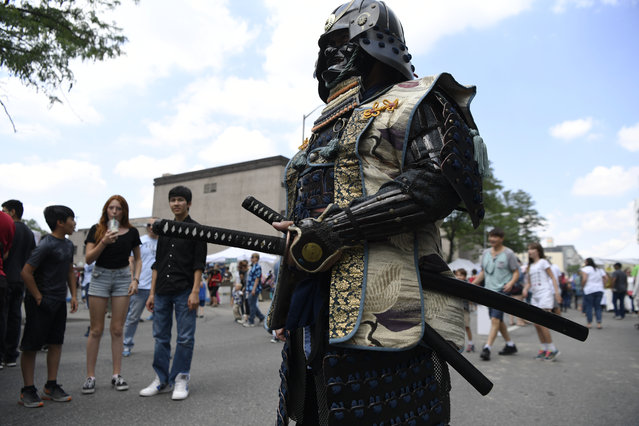 Kurt Weinrich wears his replica Samurai armor that he made at the 45th annual Denver Cherry Blossom Festival celebrating Japanese heritage and culture in Sakura Square June 24, 2017 in Denver, USA. The festival, which includes food, music performances, art and a marketplace is free and runs through Sunday 4p.m. (Photo by Andy Cross/The Denver Post)
