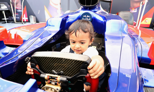A young fan sits in the Scuderia Toro Rosso car during F1 Live London at Trafalgar Square on July 12, 2017 in London, England. F1 Live London, the first time in Formula 1 history that all 10 teams come together outside of a race weekend to put on a show for the public in the heart of London. (Photo by Mark Thompson/Getty Images for Formula 1)