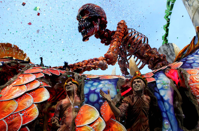Dancers perform on a float during the parade of the Mancha Verde samba school in Sao Paulo