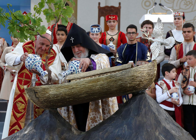 Pope Francis (L) and Catholicos of All Armenians Karekin II water a tree planted in an Noah's Ark model during an ecumenical service at the Republic Square in Yerevan, Armenia, June 25, 2016. (Photo by Alessandro Bianchi/Reuters)